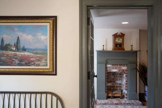 office fireplace and artwork